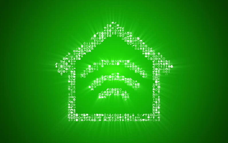 Silhouette of house with WiFi symbol - Eco Friendly Smart Homes