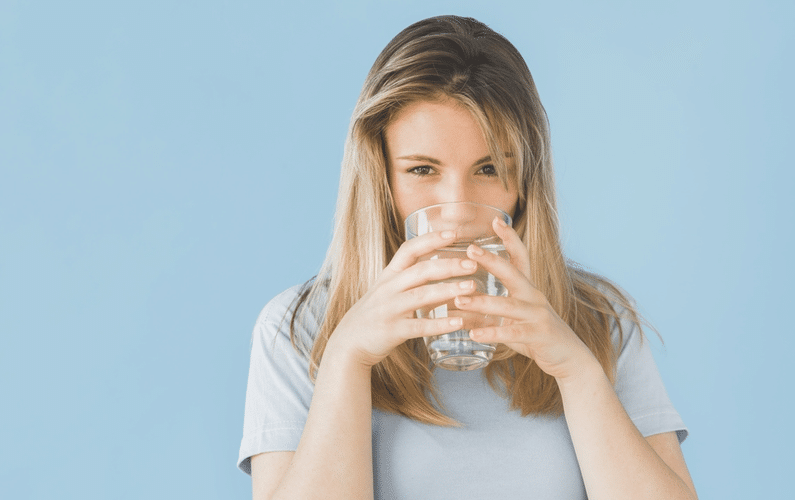 Girl Drinking Glass of Water - Intermittent Water Autophagy Fasting Facts Benefits
