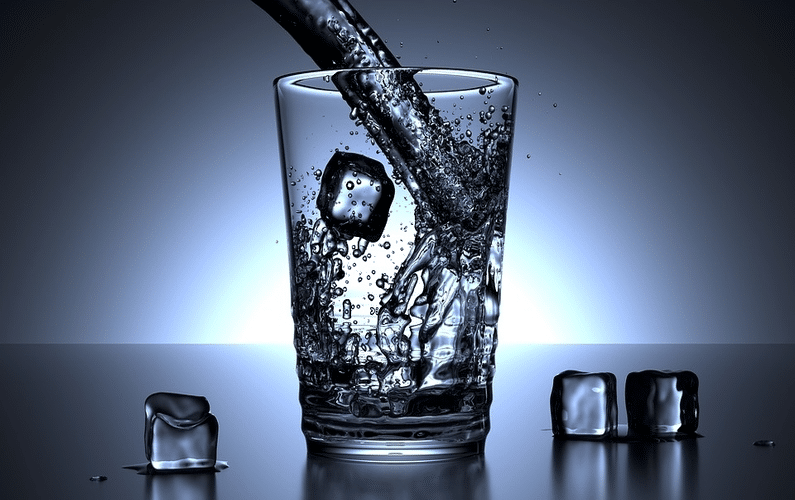Glass being filled with water - Intermittent Water Autophagy Fasting Facts Benefits