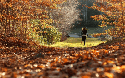 Woman Jogging in Nature - Unlock Your Health and Lifestyle Universities