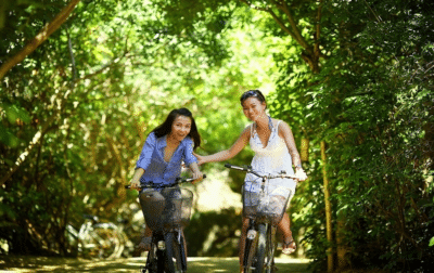 2 Women Cycling in Nature - Unlock Your Health and Lifestyle Universities